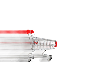 Empty shopping cart driving fast, isolated on white background