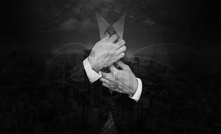 Double exposure businessman tying necktie and network in the city background. Black and white