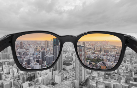 Looking through glasses to city view in sunset. Color blindness glasses, Smart glass technology Stock fotó - 119488513