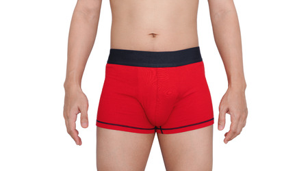 Close-up a man wearing red underpants, isolated on white backgrounds.