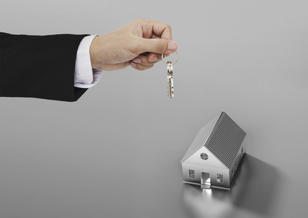 eal estate business, residential rental and investment. Businessman handover house key Stock Photo