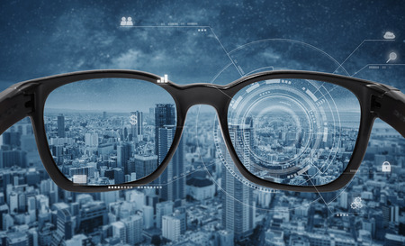 Smart glasses, VR virtual reality, and AR augmented reality technology. Smart glasses with futuristic technology graphics and modern city background