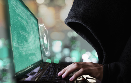 Digital data security system and protection. Anonymous hacker try to hacking on computer laptop
