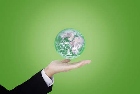 Earth day, Protect the world with environment and Eco-friendly business. Businessman hand holding green globe.