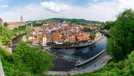 Aerial view of Cesky Krumlov city in Czech Republic with canal in summer