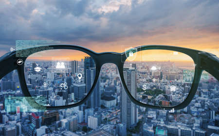 Smart glasses, VR virtual reality, and AR augmented reality technology. Smart glasses looking at the city with graphic hologram