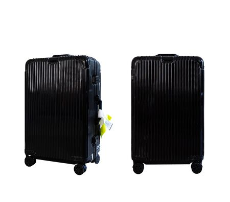 Old travel black baggage with tags, isolated on white background. Clipping path included