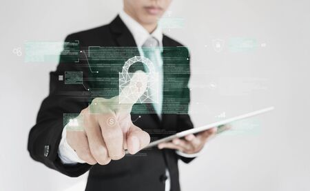 Businessman pressing on digital lock icon on screen. Business data security system technology
