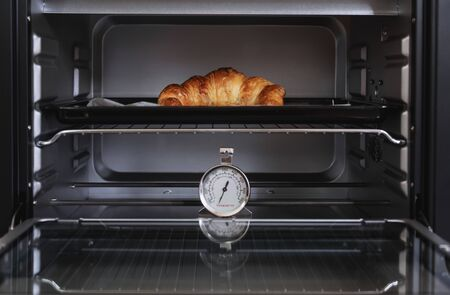 Fresh baked Croissant in oven