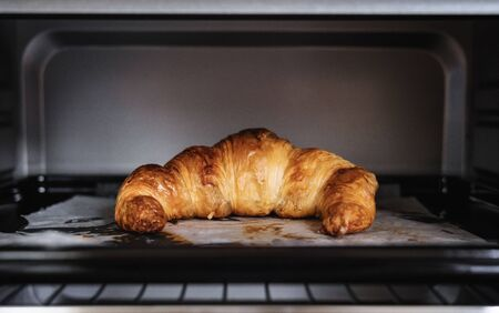 Fresh baked Croissant in oven Foto de archivo