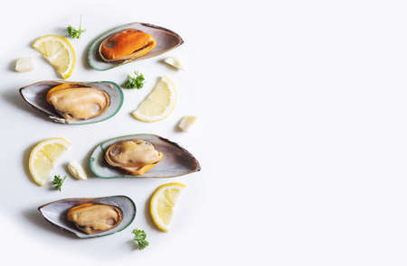 New Zealand Mussels with slices lemon, parsley and garlic, on white background