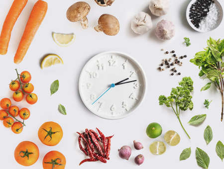 Clock surround with Food ingredient, vegetables and herbal. Dieting and healthy eating concept