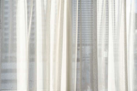Close-up white curtain with bright sunlight Imagens
