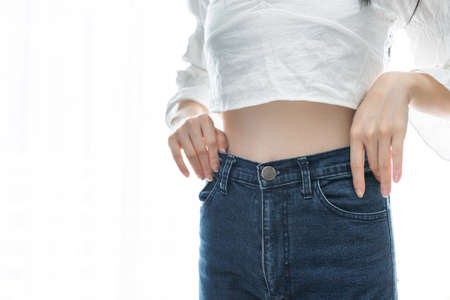Dieting and weight loss concept, Woman with slim belly