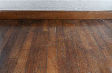 Old wood floor with white wall Imagens