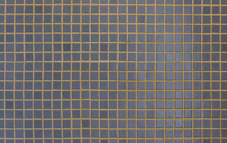 Dark gray mosaic tiles with yellow grout Imagens