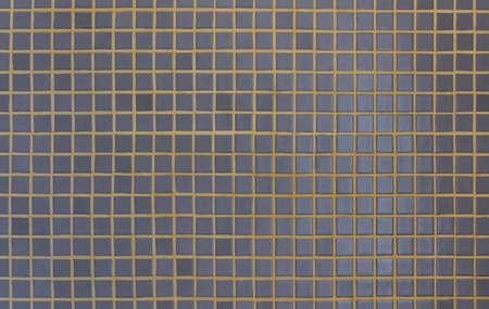 Dark gray mosaic tiles with yellow grout Foto de archivo