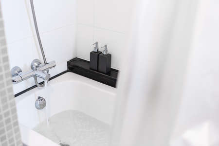 Close-up bath tub with opening water from faucet