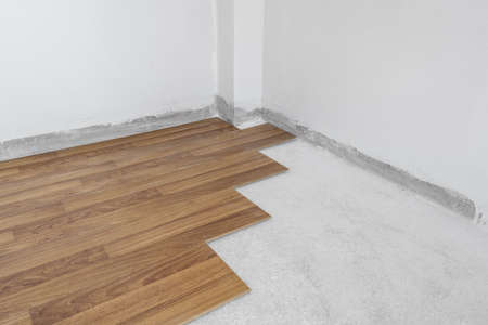 Wooden flooring installation and renovation, with base cement floor. Under construction