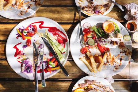 Leftover waste food, on dining table 版權商用圖片