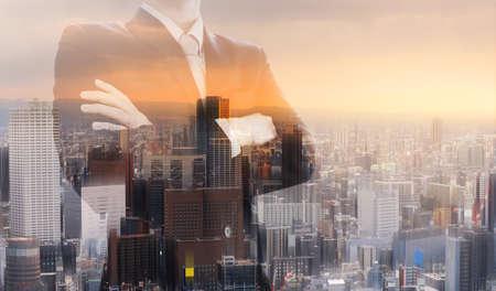 Double exposure businessman, and city sunrise background