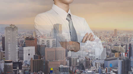 Double exposure, Businessman and cityscape in sunrise