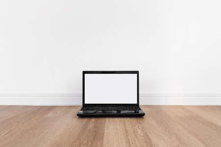 Computer laptop, blank white screen, on wood floor 版權商用圖片