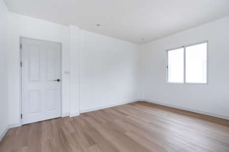 Home interior, empty room. White wall and ceiling with wood floor