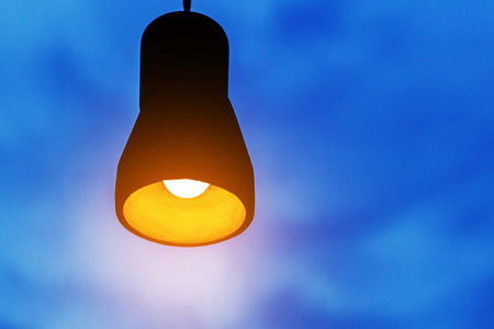 lighted bulb on a dark blue background, the concept of creativity. Copy space