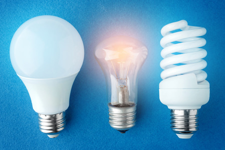 two LED lamps and an incandescent lamp on a blue background