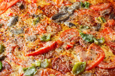 pizza closeup as background. frame filled with pizza. Top view Stock Photo