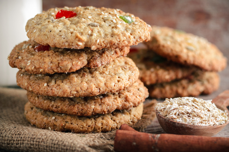 homemade oatmeal cookies and oat flakes in wooden spoon on table Stock Photo