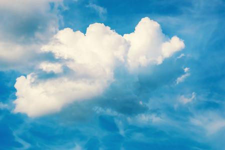 Big white cloud in blue sky close up