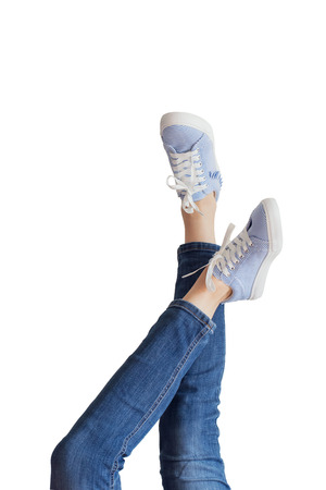Woman legs in blue jeans on white background isolated Stock Photo