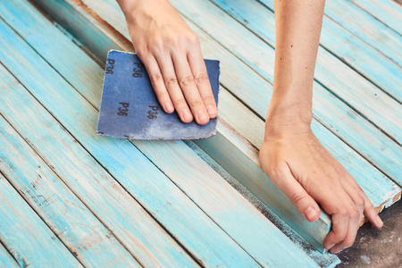 Hands polishing wooden boards with sandpaper Stok Fotoğraf
