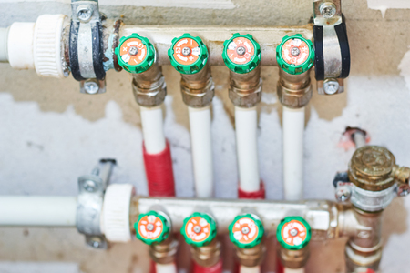 Pipes and valves for hot and cold water in heating and water supply system