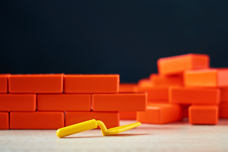 building brick wall of toy blocks. Construction concept Stock Photo