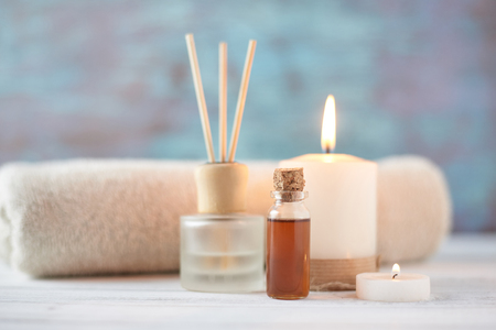Spa and relax composition with massage oil, towels and burning candle