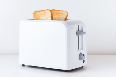 Toaster with  roasted toast bread on white background, close up