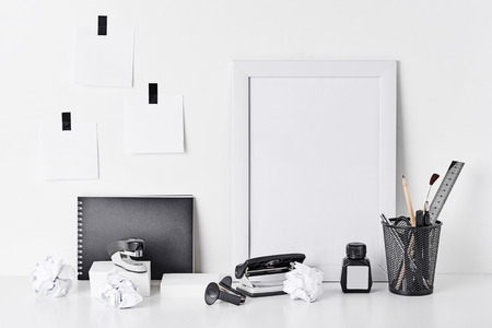 Office supplies, sticky notes and empty frame on white background, mock up. Home workplace