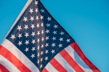 American flag in blue sky. close up. Symbol of Independence Day fourth of July in USA Imagens