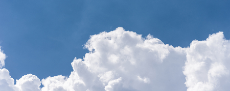 Blue sky background with fluffy clouds