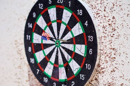 Dartboard with darts. Hit group of target in dart game
