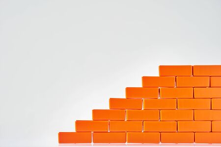Wall made of toy bricks. Block stacking as step stair