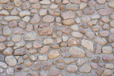 Masonry wall of stones, pattern texture background