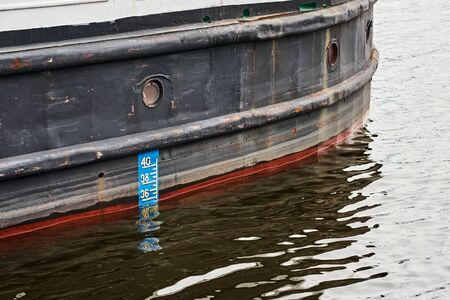 Waterline on hull of cargo ship, close up