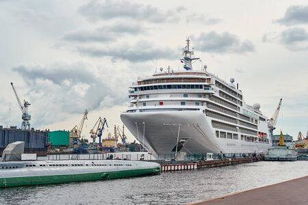 White cruis ship liner docked in port Фото со стока