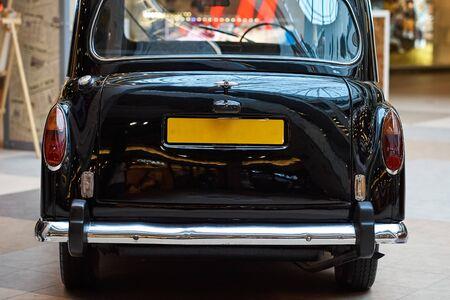 Closeup of black vintage car.  Back view part of retro car
