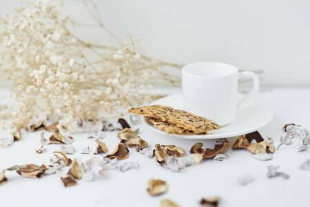 Cozy home with cup of coffee and flower branch. Hygge winter or autumn style Stock Photo