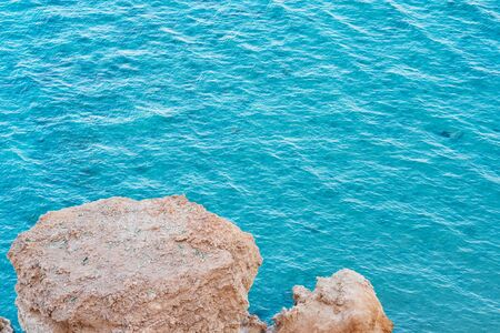 View from rock cliff on the turquoise water of sea Banco de Imagens